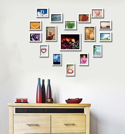 爱心照片墙效果图:卧室床头的心形照片墙,很有爱哦   高清图片