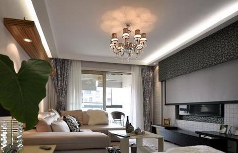 客厅过道吊顶效果图:吊灯的灯光反射到顶部墙面,行成粉红色的花朵形状